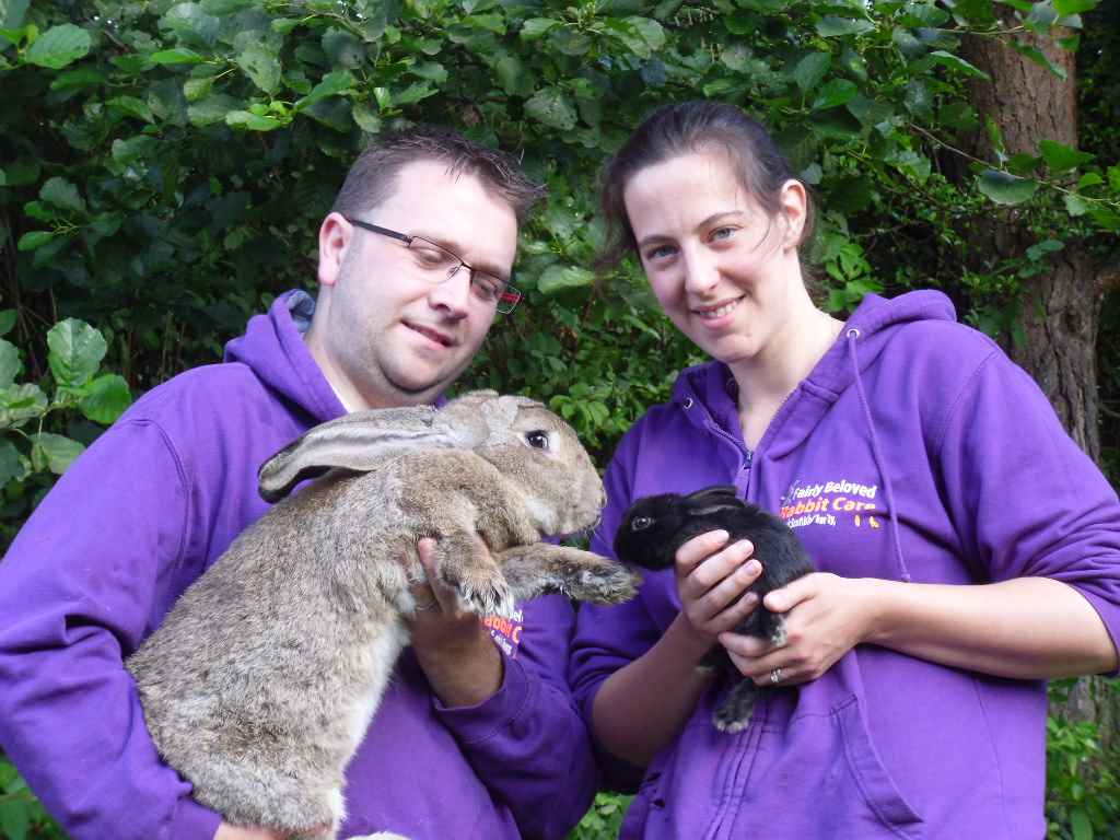David and his wife Feona with two of their pet rabbits.